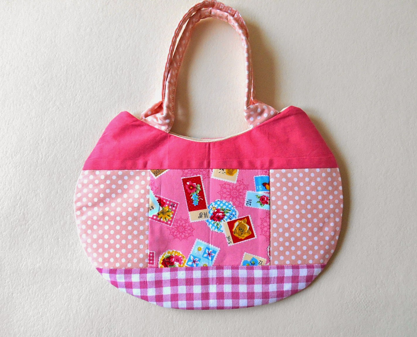 pink stamps cat face purse back