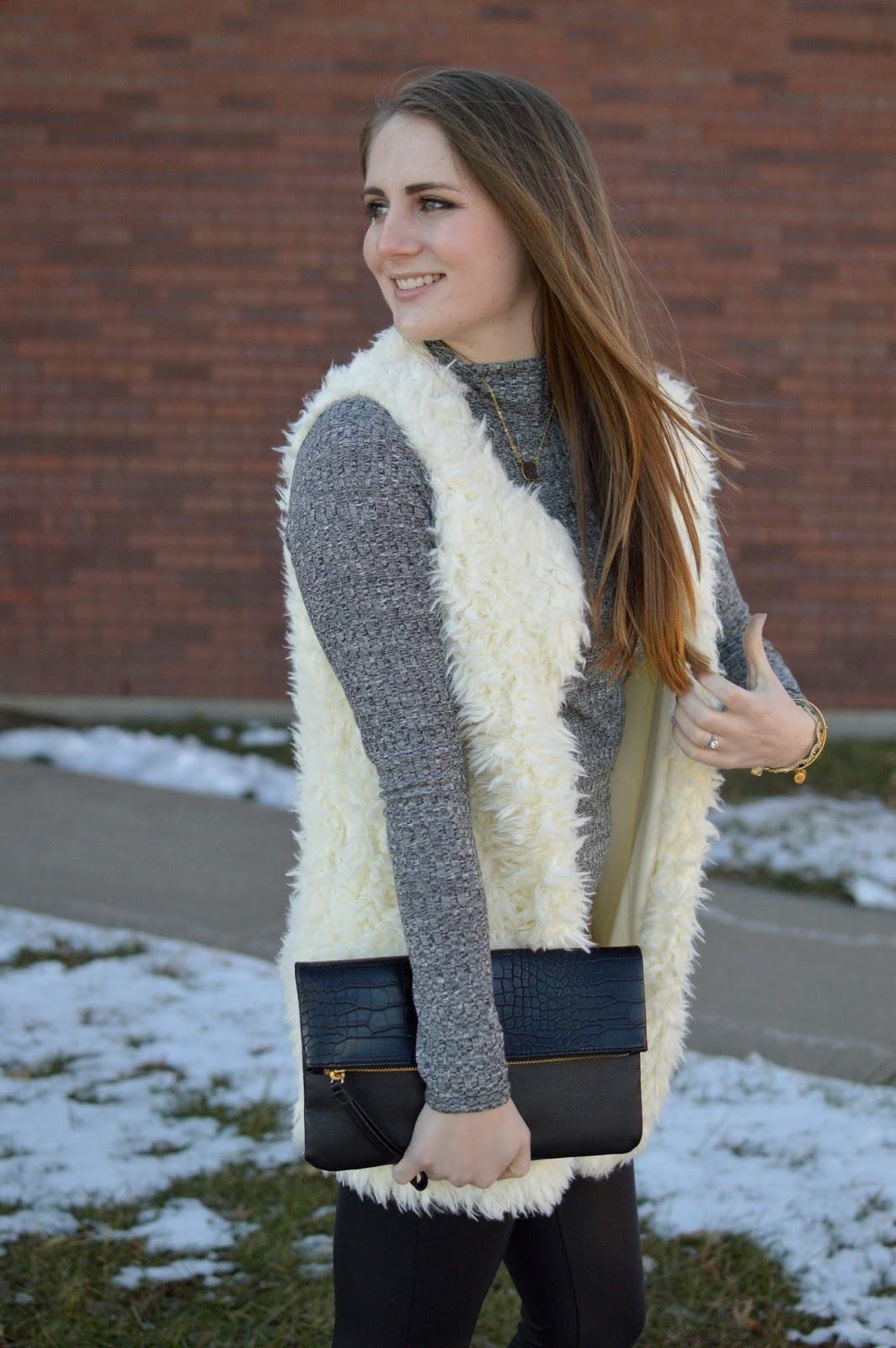 what to wear with a white fur vest