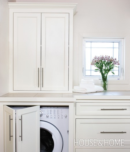 Ideas for hiding the washer and dryer driven by decor for Laundry room door ideas