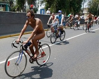 Peru cyclists stage naked protest in Lima