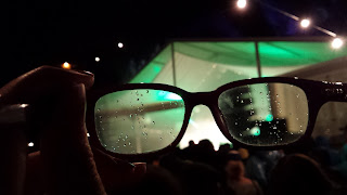 Watching a gig in pouring rain proves difficult for those with glasses