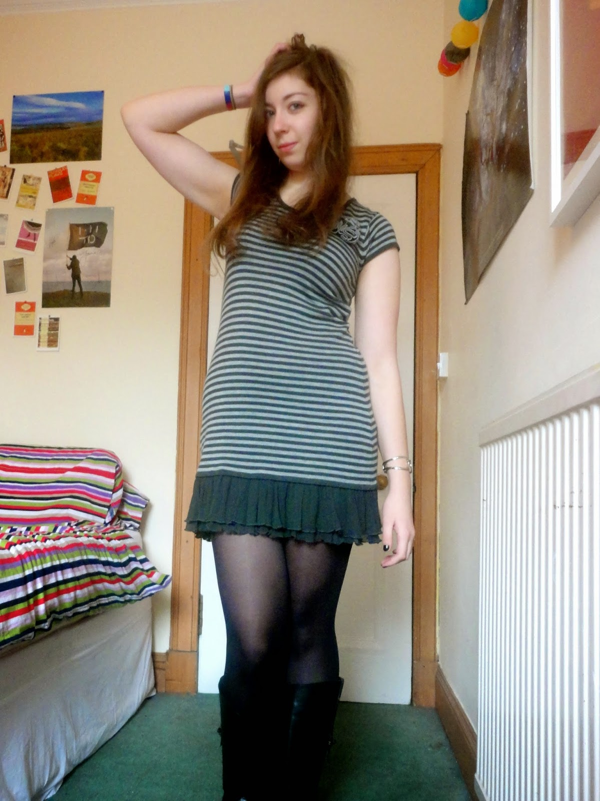 Outfit of black and grey striped dress, with black tights and leather boots