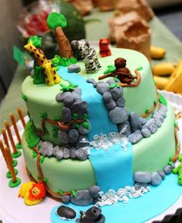 Ide kreatif kue ulang tahun pertama anak tema air terjun dan hewan
