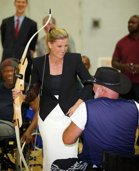 Sophie, Countess of Wessex tries her hand at archery during a visit to WheelPower at the Stoke Mandeville Stadium