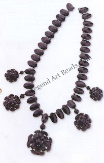 A French-jet necklace dating from c.1880-90. French jet was used to imitate Whitby jet and polished up to a high sheen. Each individual faceted piece is set onto a blacked-out metal frame, which is linked together.