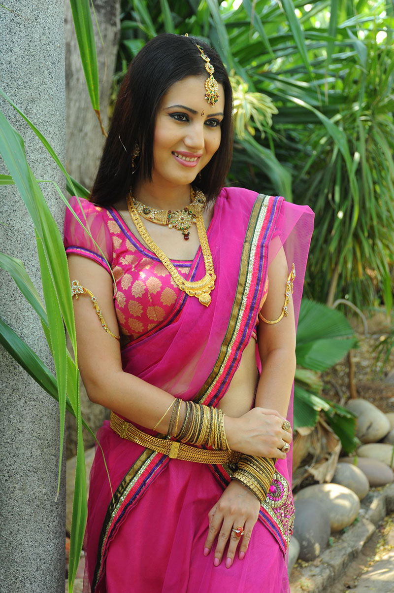 ethnic and ornamental Anu smruthi dazzling photos in pink designer saree at heroine movie launch