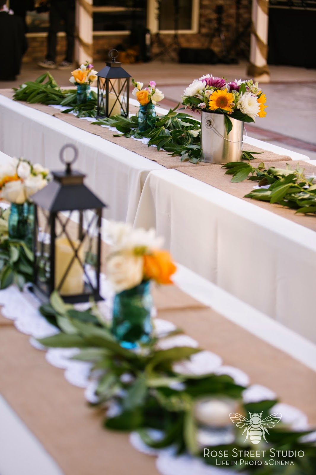 Rustic greenery and lantern wedding tables l Rose Street Studio l Take the Cake Event Planning
