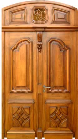 Kerala style carpenter works and designs main entrance for House front double door design