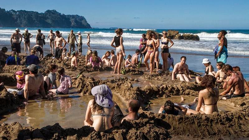 Hot Water Beach is a beach on the east coast of the Coromandel Peninsula, New Zealand