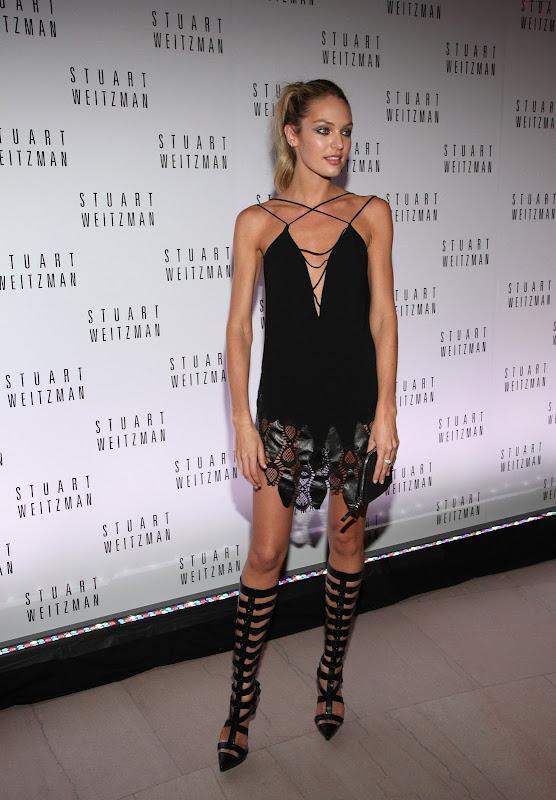 Candice Swanepoel attends Mario Testino Exhibit
