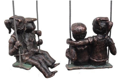 Bronze children on a swing