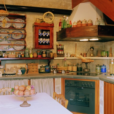 [A lively kitchen with a lot of items placed everywhere possible]