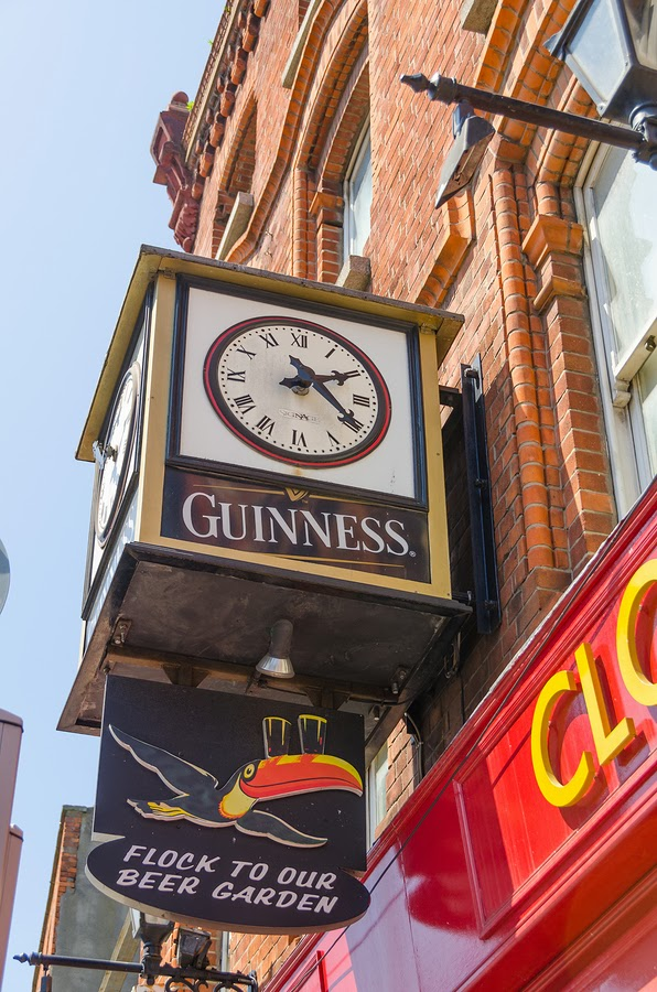Guinness clock & pub sign in Dublin