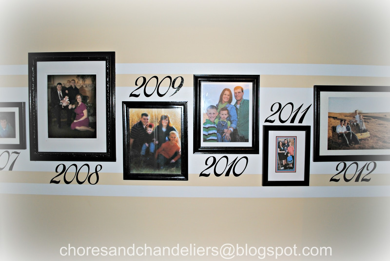 chores and chandeliers: Family Pictures / Hallway display