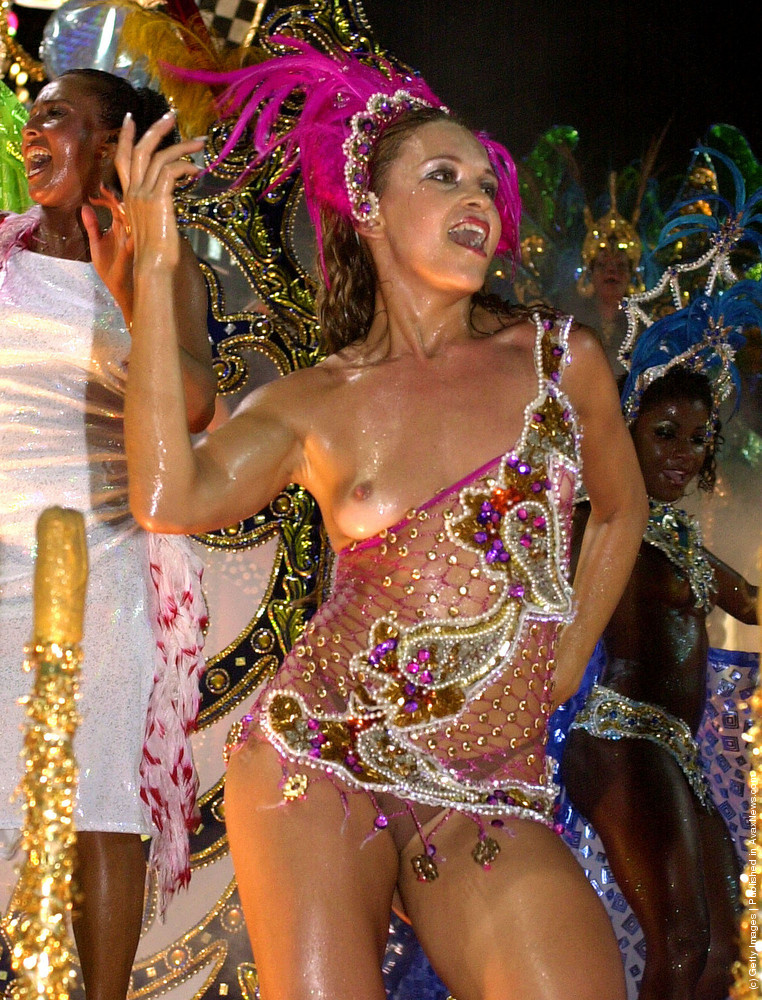 A Brazilian samba school during the annual carnival parade in Rio de Janeiro, Brazil. The 14 samba schools are the main attraction of Rio de Janeiro's carnival, performing to approximately 70,000 spectators on a stadium built especially for it.
