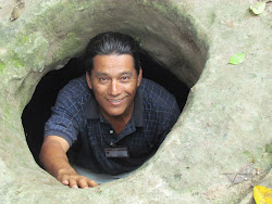 My Tikal guide Abel Lucero, at Mayan storage hole near El Mundo Perdido