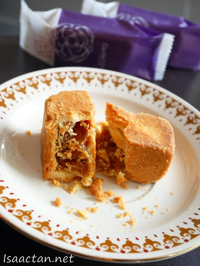 Break it open, and the crumbs bear testament to the soft flaky texture of Gartien Pineapple Cakes