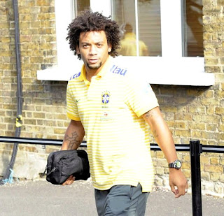 Marcelo wearing the Brazilian national team polo
