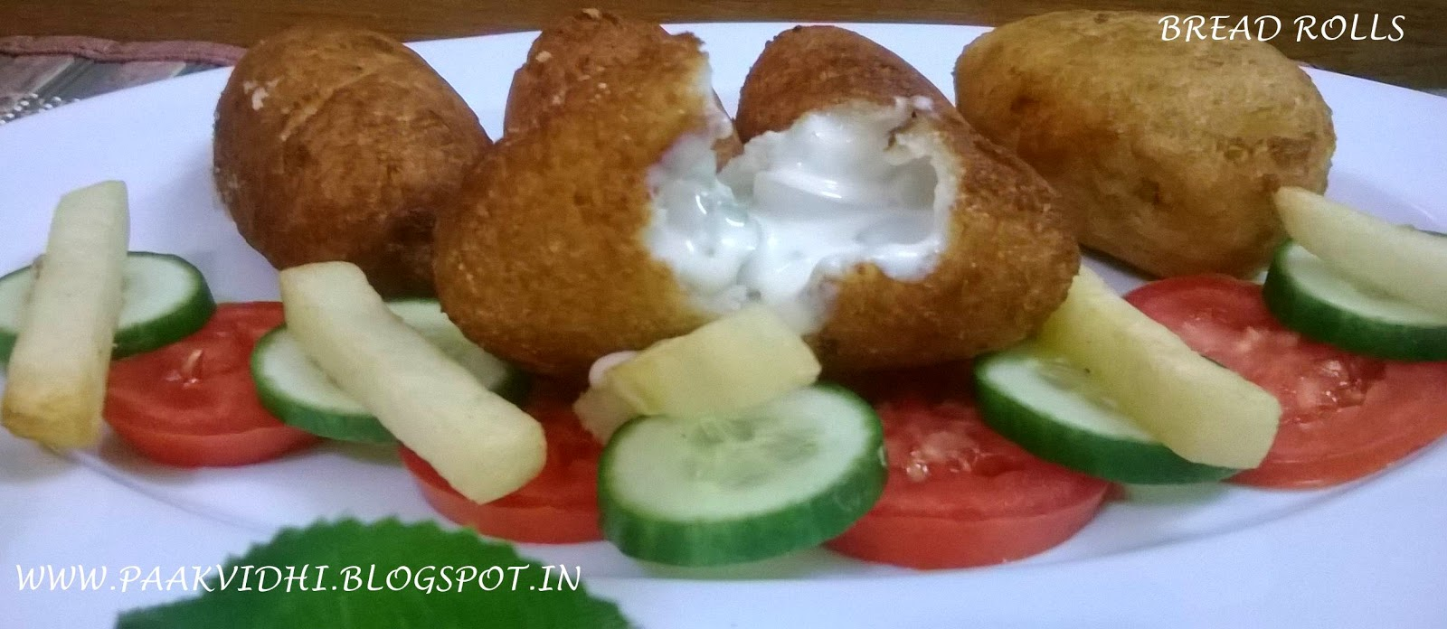 http://paakvidhi.blogspot.in/2014/06/cheese-corn-bread-rolls.html