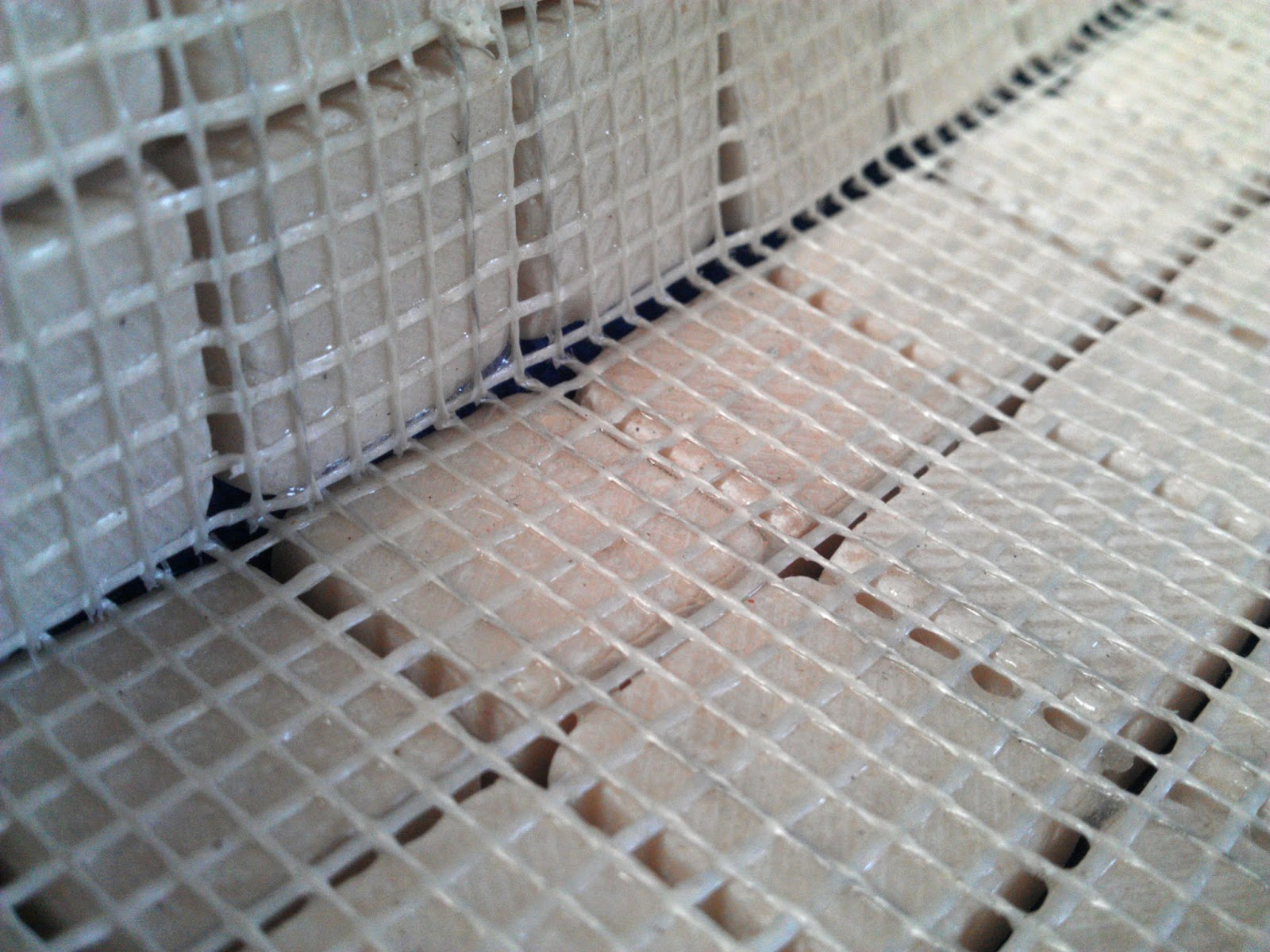 The Mesh Backed Tiles Right Used In This Project Left Were Not Suitable For Swimming Pools Due To Lack Of Adhesion Area On Back Tile