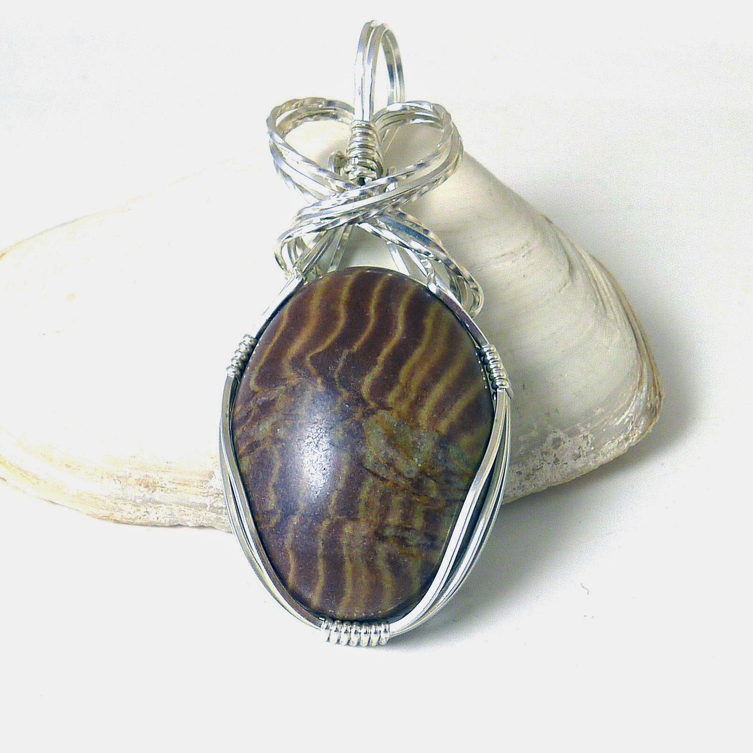 http://www.shazzabethcreations.co.nz/#!product/prd1/2574335161/brown-zebra-jasper-and-sterling-silver-pendant