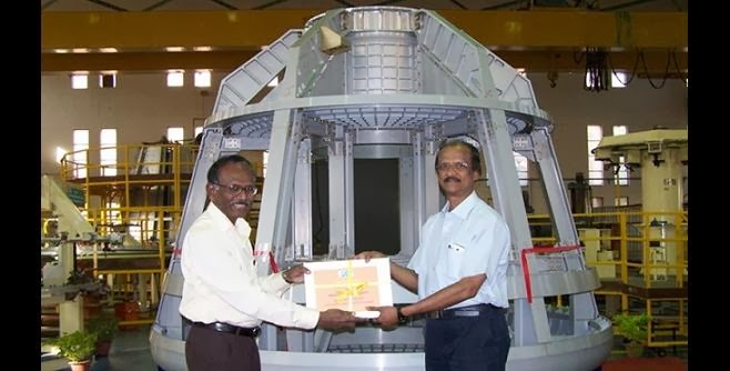 On behalf of HAL, quality documents were handed over by  Dr. Jeyakar Vedamanickam, GM, Aerospace Division, HAL (left) to Shri John. P. Zachariah, Director (R&D), VSSC in the backdrop of the Crew Module Structure. Credit: HAL