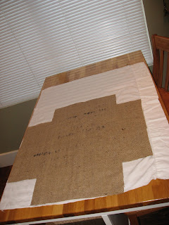 Once the burlap is cut to size i then cut a lining fabric to the