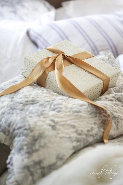 Christmas present on toile bedding
