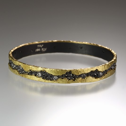 http://quadrumgallery.com/jewelry/product/wide-fissure-bangle