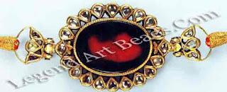 Petals of rose cut diamonds set in gold encircle a foiled crystal centre-piece.