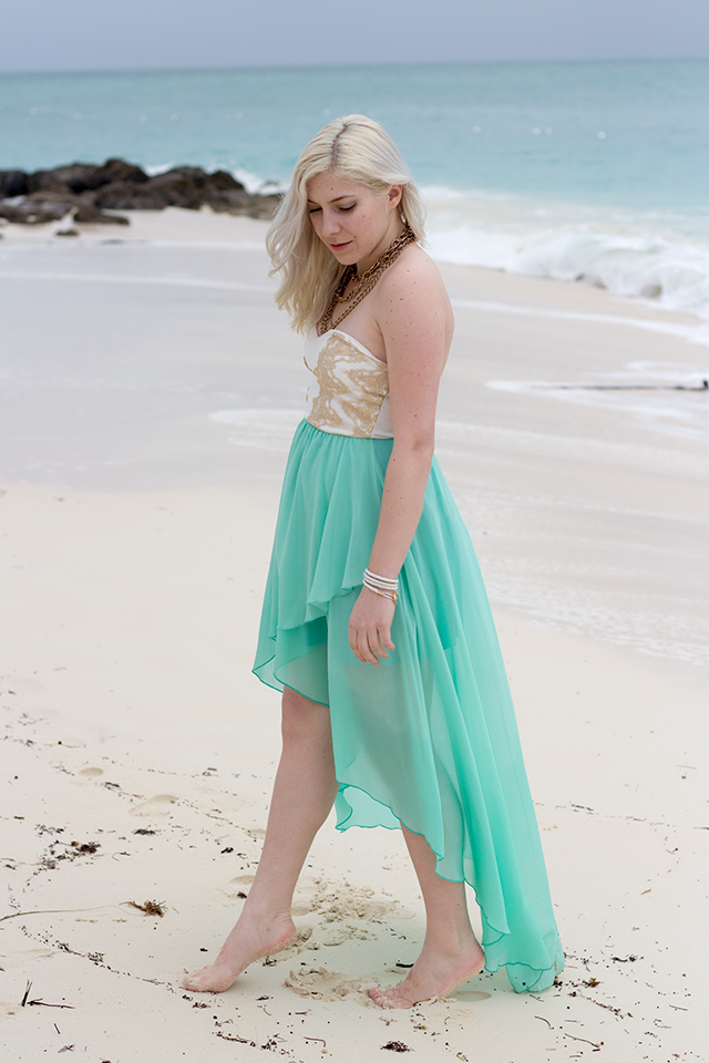 Aqua chiffon dress with gold lace accents.