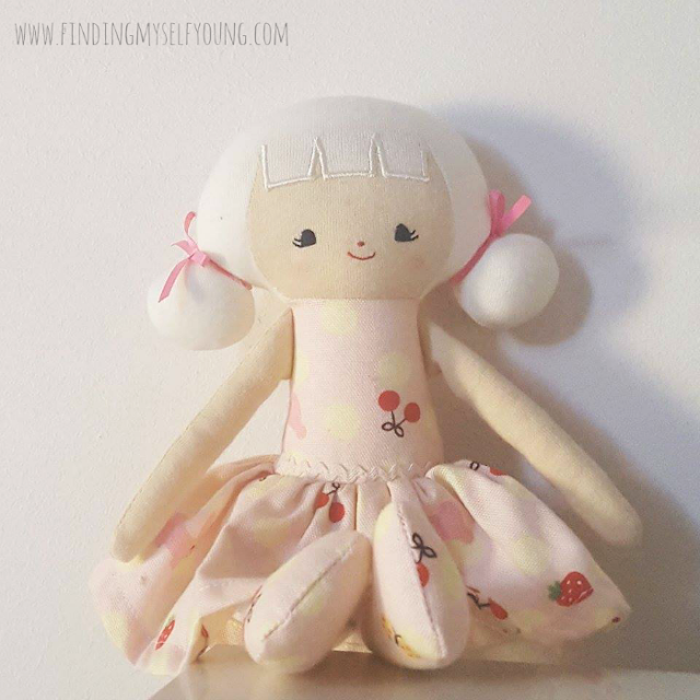 Alimrose designs Audrey doll sitting