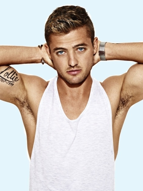 Robbie Rogers wearing vest in OUT Magazine