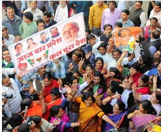 BJP workers celebrate the party's thumping victory in the Madhya Pradesh Assembly polls