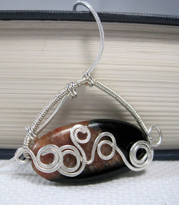 Hammered wire wrapped pendant