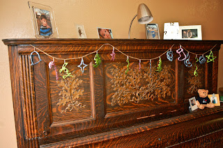 glue and glitter ornament banner on piano