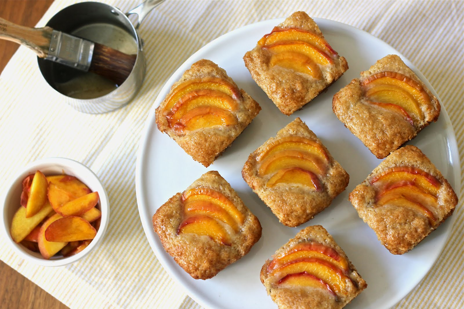 yogurt cakes topped with sliced peaches and a honey cinnamon glaze ...