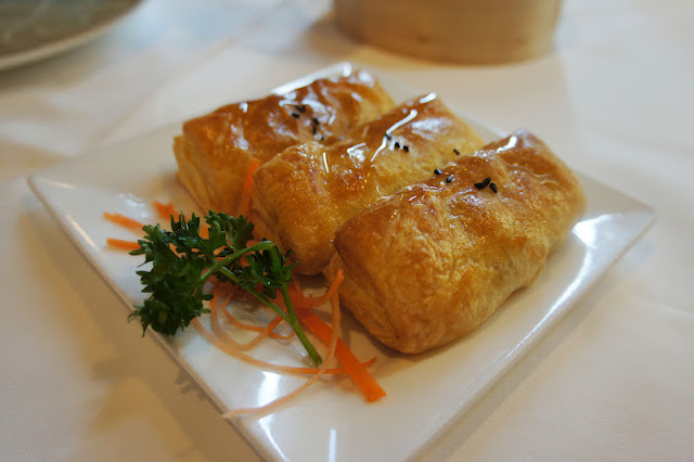 baked puffy turnover filled with minced barbequed pork & pineapple