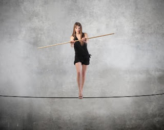 Image credit: <a href='http://www.123rf.com/photo_8588254_beautiful-woman-standing-on-a-rope.html'>bowie15 / 123RF Stock Photo</a>
