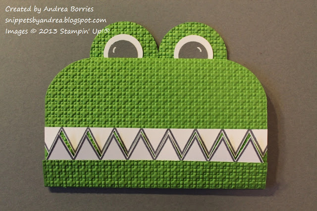 Card shaped like a crocodile face with triangle teeth and large round eyes.