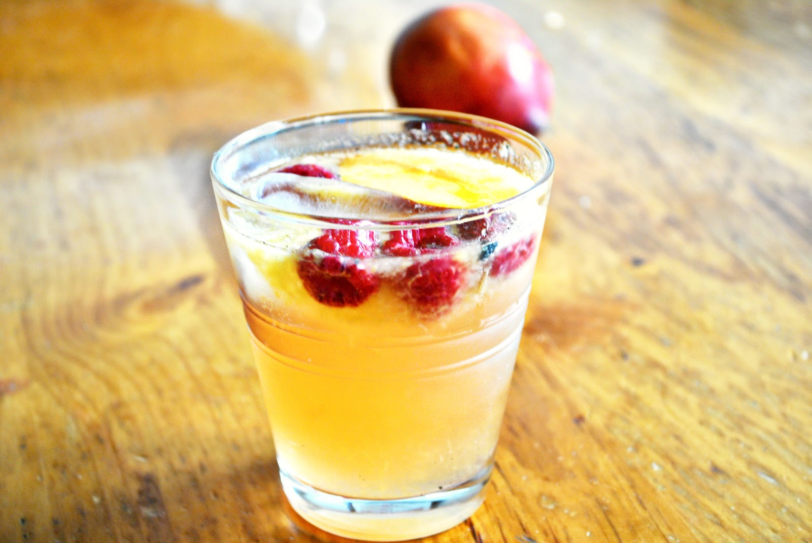 In the Kitchen with Little Buddy: Stone Fruit and Raspberry Sangria