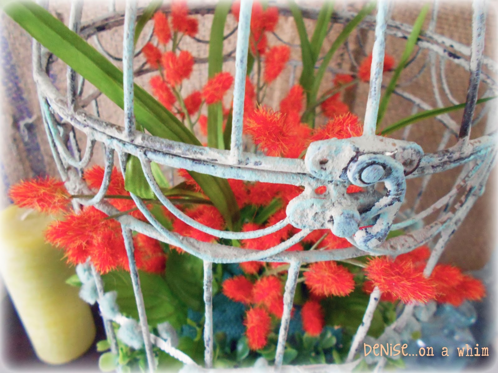 Orange Stems and Faux Boxwood in a Shabby Birdcage via http://deniseonawhim.blogspot.com