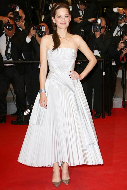 Marion Cotillard teamed a Christian Dior gown with Christian Louboutin heels and jewellery by Chopard at Cannes 2014