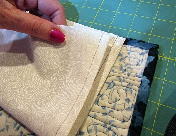 adding a quilt sleeve