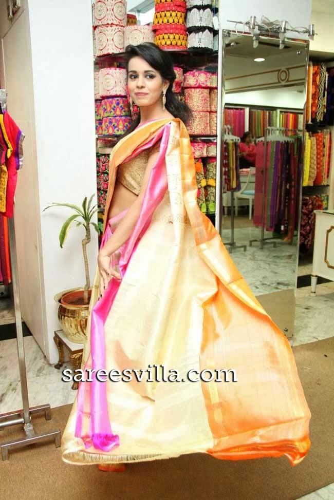 Model in cream uppada silk saree