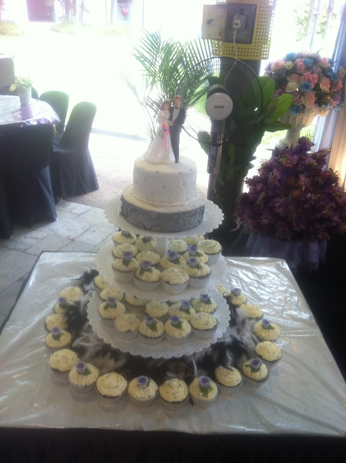 Izah s Kitchen Wedding cupcakes Purple and Silver theme