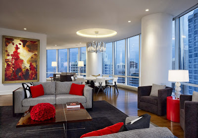 the living room area combines white, black and red in style and enhanced by lighting fixture