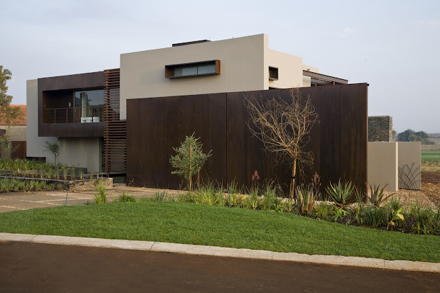 Brown modern facade of Serengeti House by Nico van der Meulen Architects