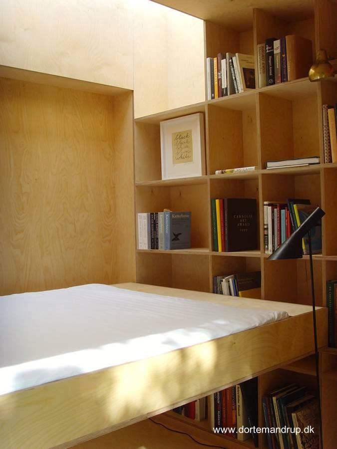 Cama abatible y biblioteca