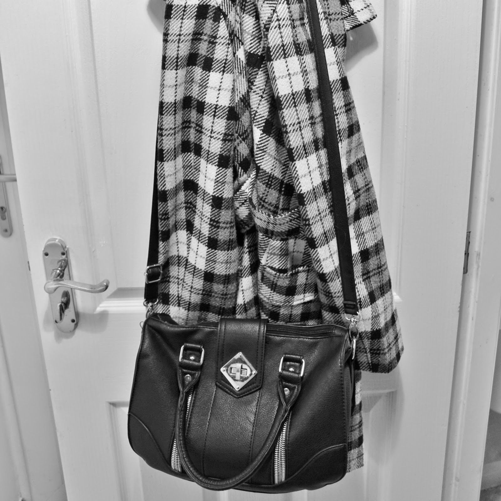 Bag and Coat hanging on door